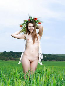Pale-Skinned Slim Girl Posing Totally Naked In A Field Of Grass